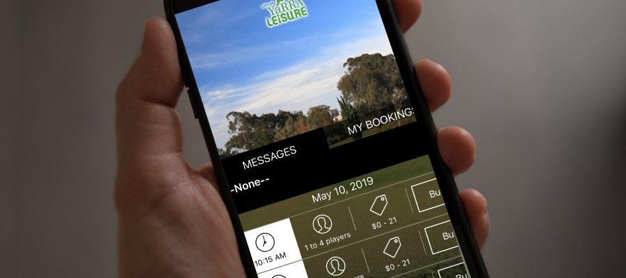 Person holding a mobile phone with the Burnley Golf Course app on screen