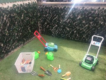 Tools and lawnmowers for the children to help maintain the garden!