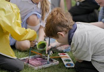 Children mixing colours on a paint palette