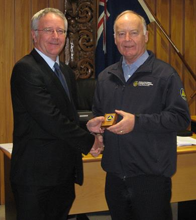 Dave Jack receives his long service award from Director CDEM John Hamilton.