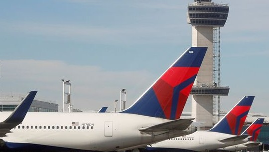 Photograph of Delta airplanes parked on the tarmac at John F Kennedy International Airport in New York.