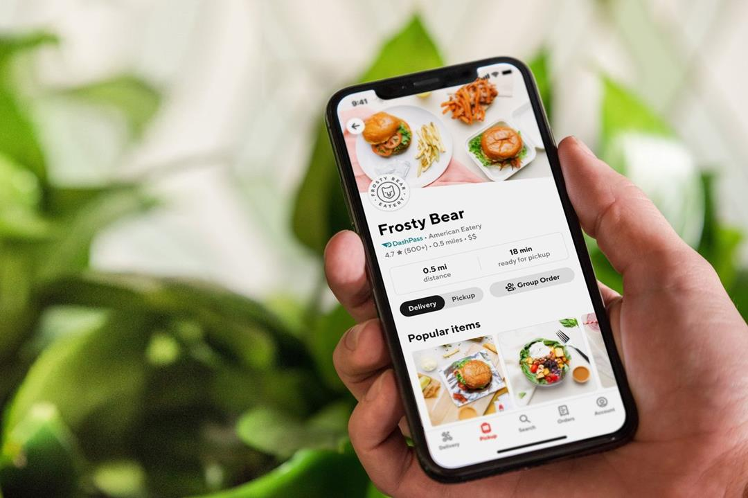 The DoorDash app appears on a smartphone.