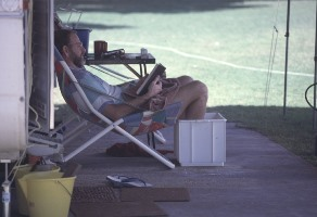 Reading and relaxing in the caravan park, Coral Bay. R. Garwood, 1992. Courtesy of State Library of WA CN#b4257022