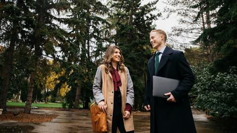 image of two students walking on the U of A campus