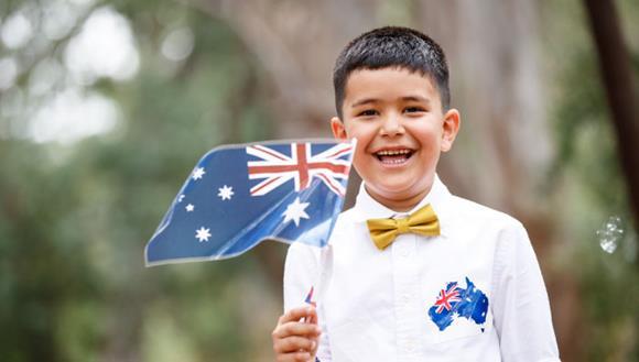 Boy waving Australian flag