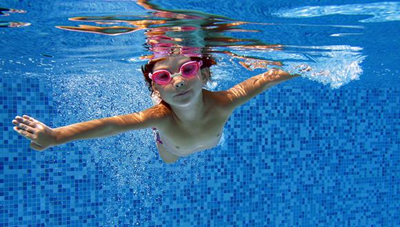 Child underwater in swimming pool