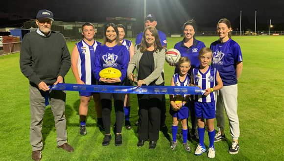 Mitchell Shire Mayor Cr Rhonda Sanderson is joined by Cr Bill Chisholm and members of the    Broadford Football Netball Club at the launch of the Harley Hammond Reserve Oval Lighting project.