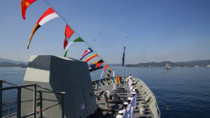 HMAS Anzac sailors line the decks for fleet inspection at Lombok, Indonesia. Defence