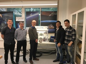Benjamin Southwell, Dr Eamonn Glennon, Prof Andrew Dempster, Dr Joon Wayn Cheong, and Dr William Crowe with a model of the cubesat in the ACSER lab, UNSW Sydney.