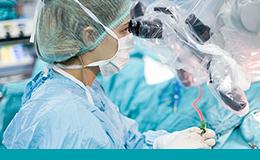 Surgeon looking through robotic surgical equipment