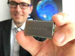 Myriota CEO Dr Alex Grant with one of Myriota's low-cost, long battery life satellite transmitters. Credit: Myriota