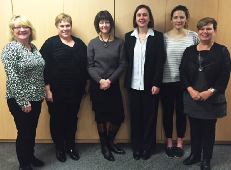 A group pf women meeting with the visiting Welsh nurse