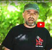 Screencap of Patrick Lucas speaking outside. From the short film Allies, about Lucas and Thomas Schoen's Aboriginal Youth Mountain Bike program.