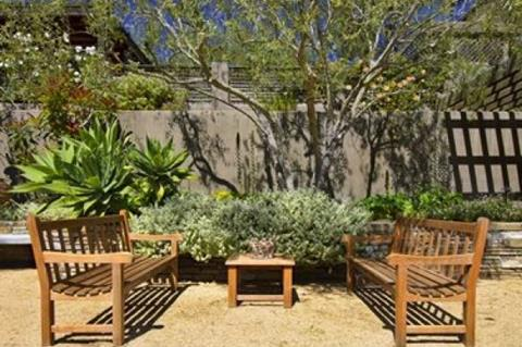 Outdoor furniture in Mediterranean garden