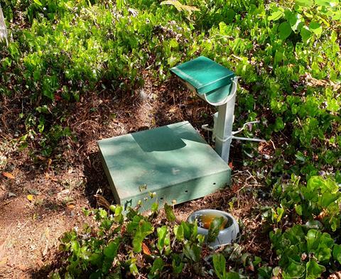Hopper feeder. Photo by J. Crane