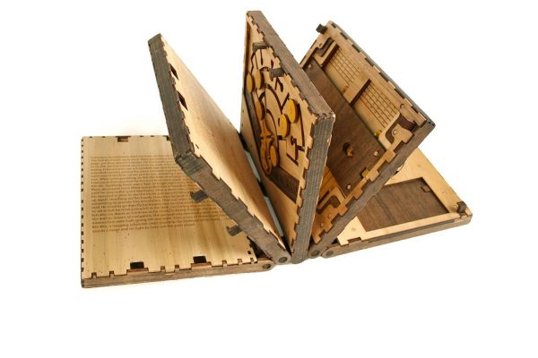 THIS WOODEN PUZZLE BOOK MAKES YOU SOLVE A PUZZLE TO TURN EACH PAGE