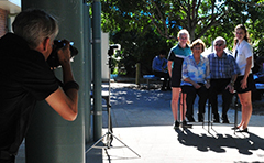 Students and seniors being photographed