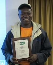 Ateh Wilson accepts the Siddle-Marsden award at PASA's management workshop in Nairobi, Kenya