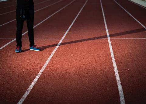 Image of an athlete on a running track