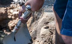 Photo of man digging hole