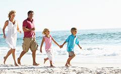 Family on beach at Discovery Coast