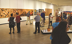 People viewing art gallery exhibition