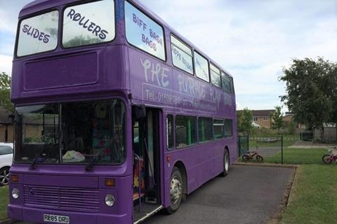 Large bus painted purple