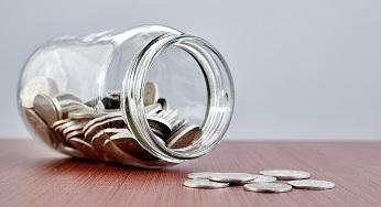 Jam jar with coins