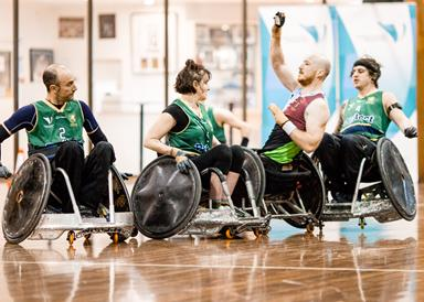 Group of people playing wheelchair rugby