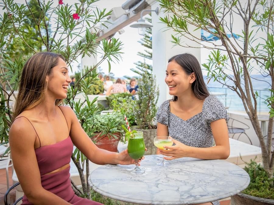 Guests dining waterside at Coogee Pavilion