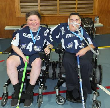 Two men sitting in electric sportschairs ready to play powerchair hockey