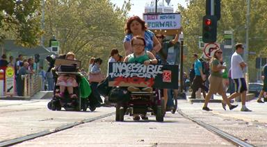 Melbourne protesters for disability rights protesting in Melbourne CBD