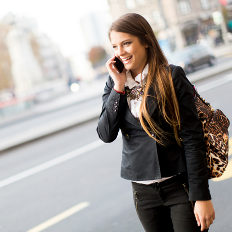 Woman talking on the phone while walking
