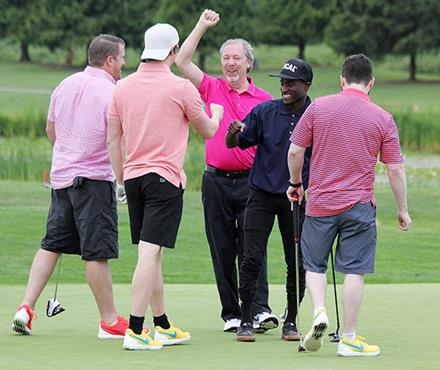 Goldcorp Invitational golfers congratulate Special Olympics putter Malcolm Borsoi