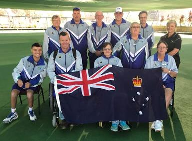 Bowlers with a Physical Disability Victorian Team holding the state flag