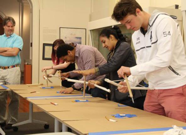 Image of students making bone flutes