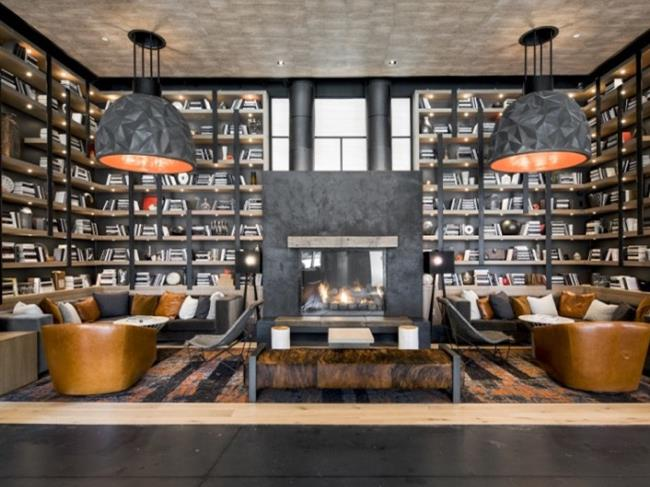 A Black Concrete Floor Fits Perfectly in this Industrial Chic Apartment Lobby