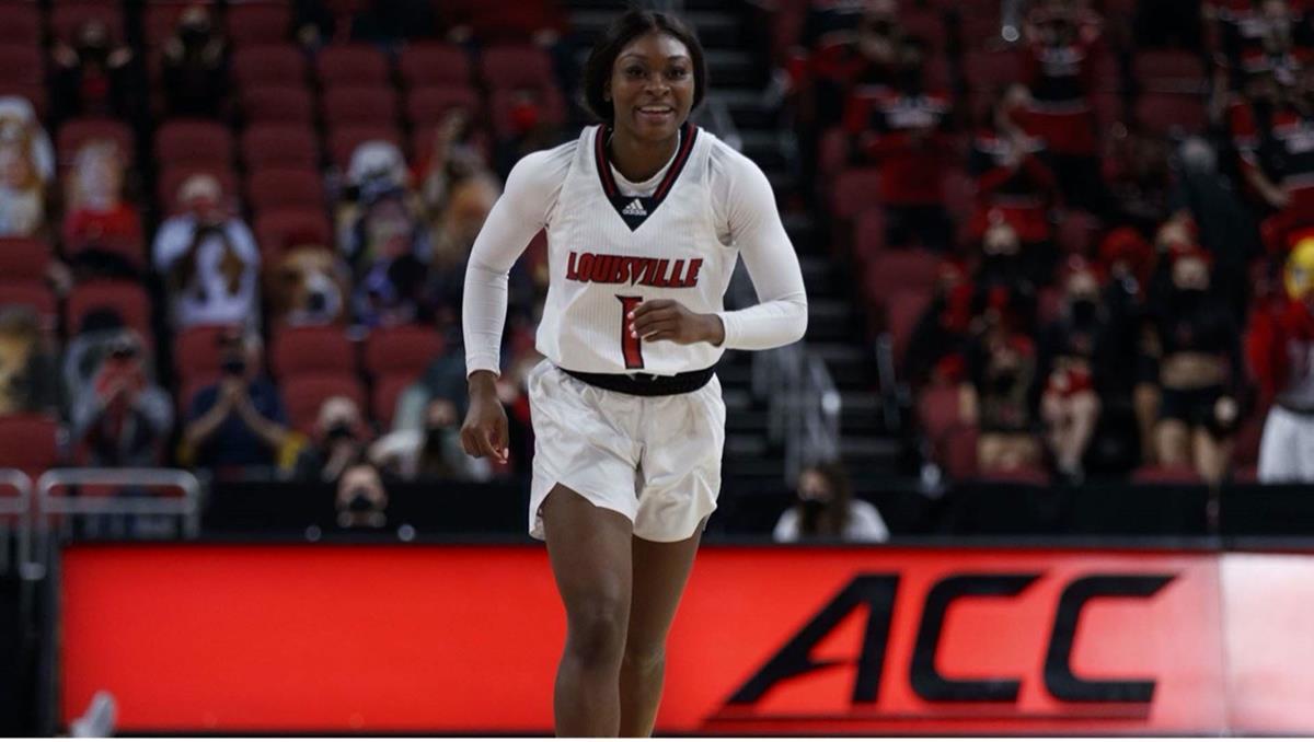 Louisville women's basketball player running on court during game