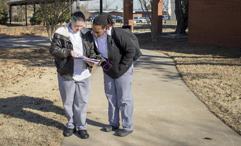 Culinary students Madison Garrett, left, and Danara Manous, look over schedules on the first day of the spring semester.