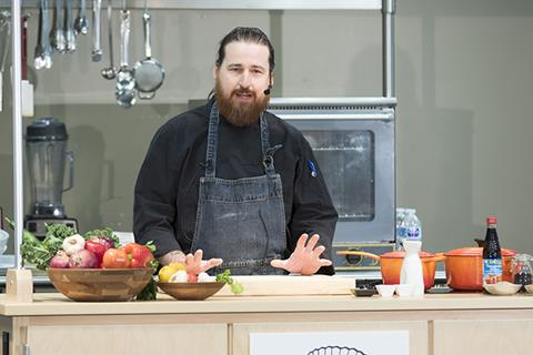 Chef Josh Valentine conducted a cooking demonstration Tuesday as part of the Cowboy Chef's Table luncheon series.