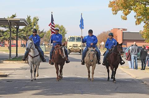 Members of the Right Path Riding Academy's Hooves on the Ground group take part in the Veterans Day Parade on the OSUIT campus.