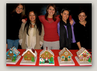 Photo: Finalists in MDG's holiday gingerbread decorating contest show off their creations. Jacquelyn Clair and Vanessa Espinosa tied for first-place. All entries were good enough to eat!