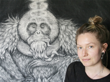 Bethan McFadden with charcoal Orang-utan drawing. © Bethan McFadden.