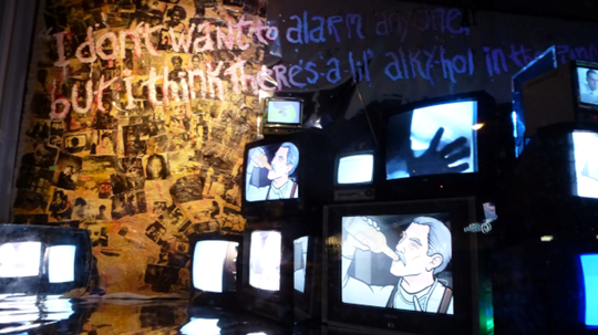 Art installation featuring multiple TV screens piled onto each other