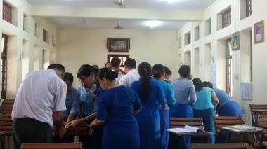 Trainees mingle during a classroom activity