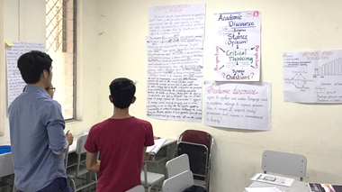 Students in Cambodia look at how to structure an academic argument in English