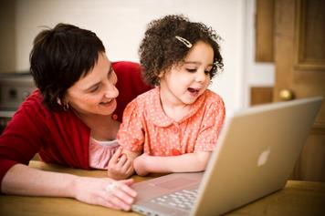 A mother and her child using a laptop