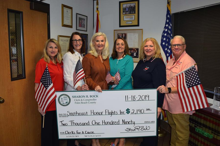 Clerk & Comptroller Sharon R. Bock and Chief Operating Officer Shannon R. Chessman presented a check to Southeast Florida Honor Flight representatives on behalf of the Clerk office's employees.