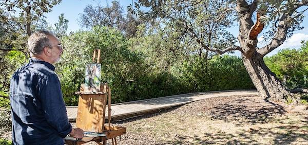 Artist painting tree