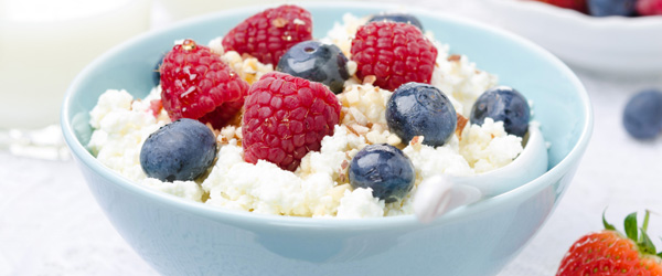 Photo of bowl of cottage cheese topped with blueberries and raspberries